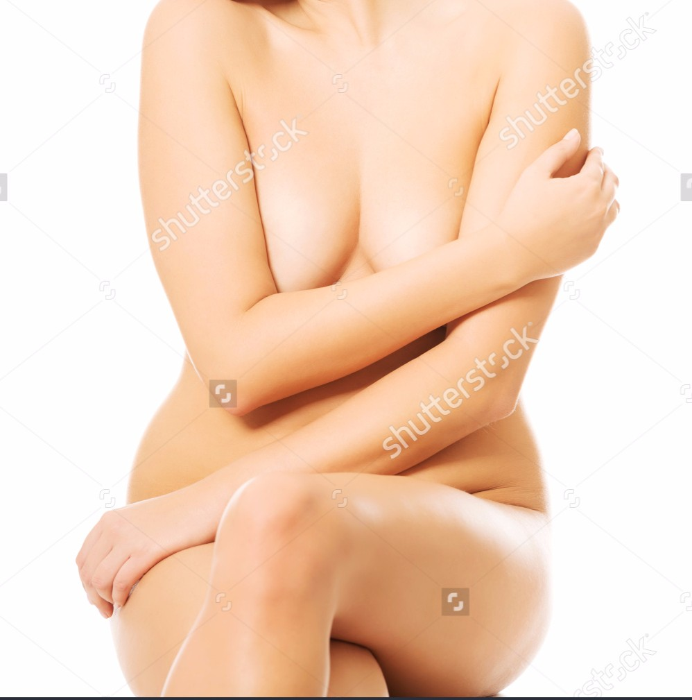 Nude Woman Sitting On Something Invisible Putting Arm On Breasts 1.jpg