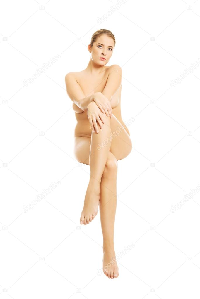 Nude Woman Sitting With Crossed Legs In Sexy Position.jpg