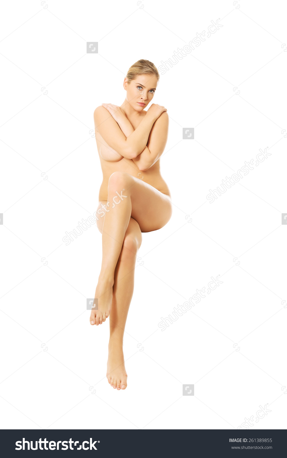 stock-photo-full-length-of-nude-woman-sitting-with-crossed-hands-261389855.jpg