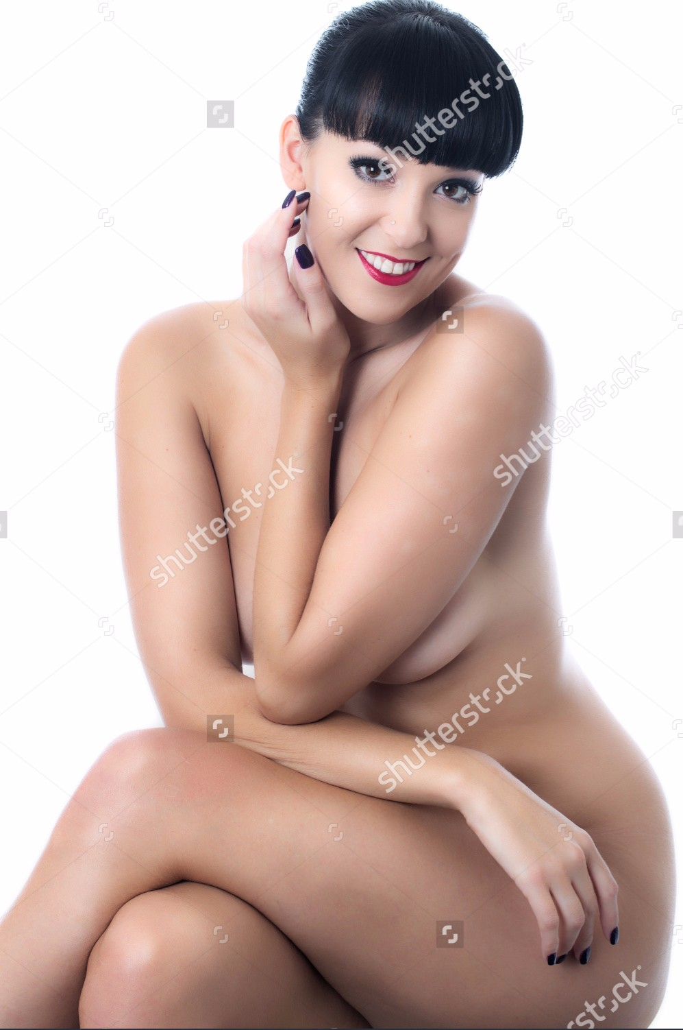 stock-photo-nude-young-lady-sitting-on-a-stool-163722737.jpg