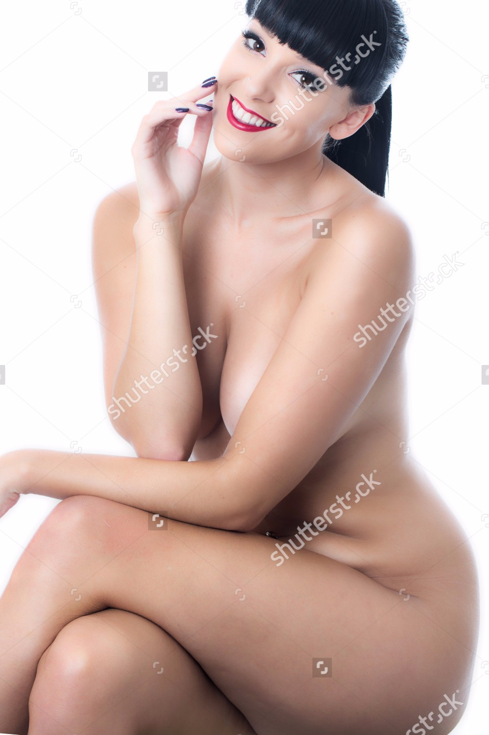 stock-photo-nude-young-lady-sitting-on-a-stool-163722746.jpg