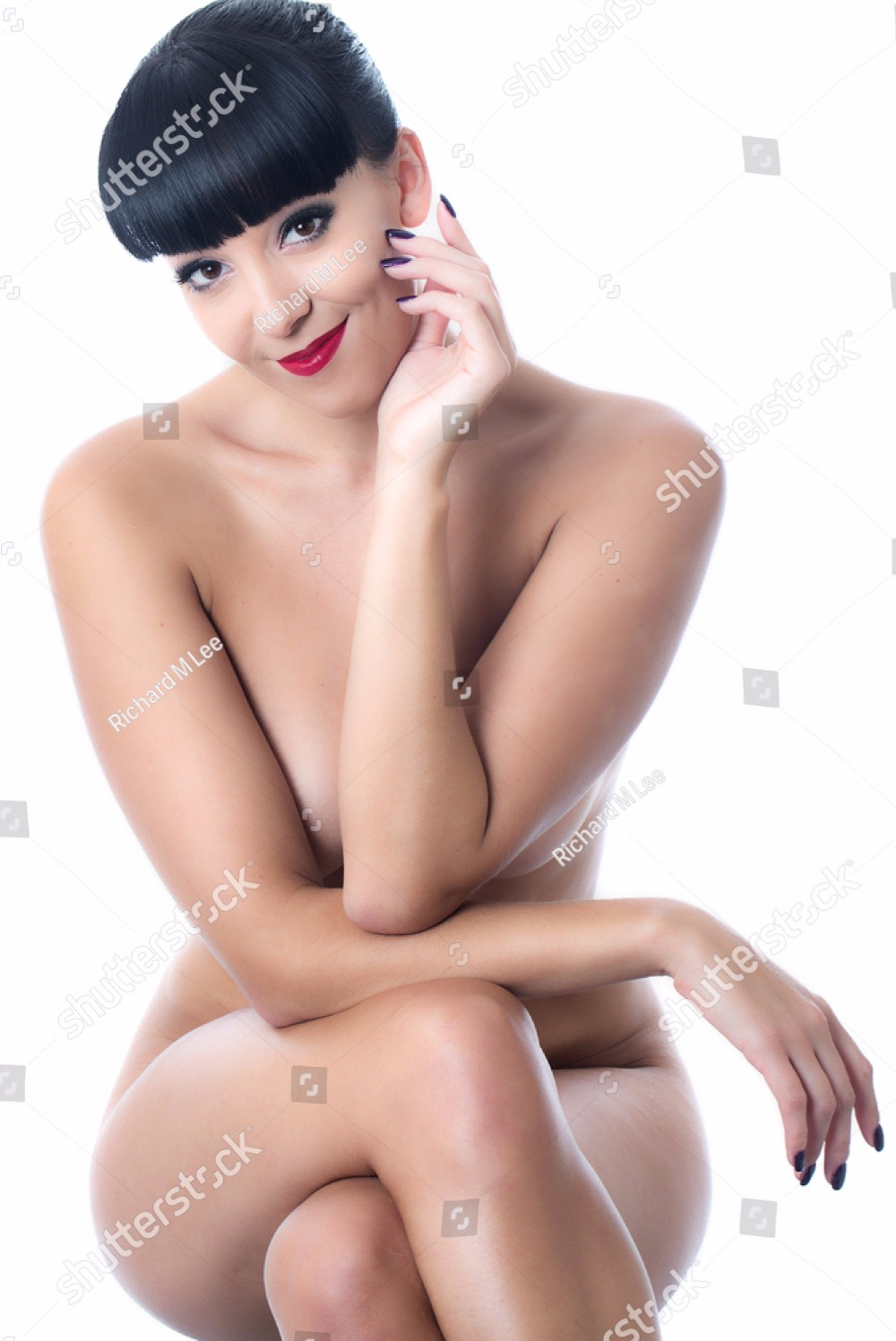 stock-photo-nude-young-lady-sitting-on-a-stool-163722839.jpg