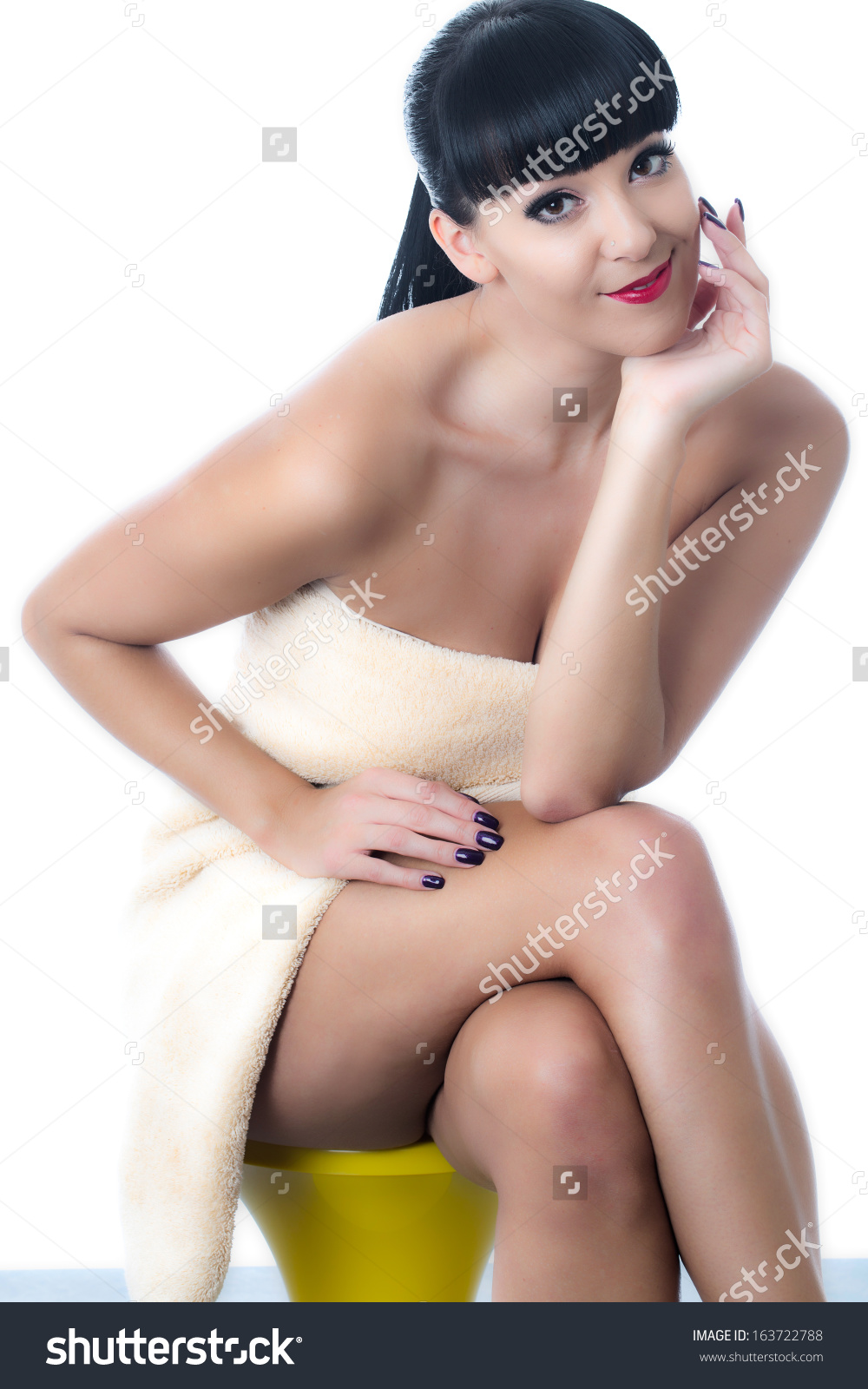 stock-photo-thoughtful-young-woman-wearing-a-towel-163722788.jpg